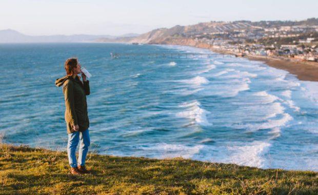 woman pondering nature for her environmental studies degree
